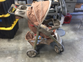 Orange and grey prop stroller